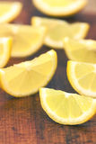 Lemon slices. On a wooden background Stock Photo
