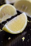 Lemon. Slices with  zest on wooden board Royalty Free Stock Images