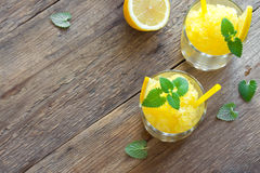Lemon Slush. Lemon Frozen Granita Slush Drink in glasses on rustic wooden table. Homemade Italian Granita Dessert, refreshing summer Slush Drink Royalty Free Stock Photo