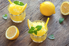 Lemon Slush. Lemon Frozen Granita Slush Drink in glasses on rustic wooden table. Homemade Italian Granita Dessert, refreshing summer Slush Drink Stock Photography