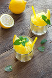 Lemon Slush. Lemon Frozen Granita Slush Drink in glasses on rustic wooden table. Homemade Italian Granita Dessert, refreshing summer Slush Drink Royalty Free Stock Photos