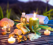Lemon soap , oil, towel, salt and candles in garden. Aromatherapy - lemon soap , oil, towel, salt and candles in garden stock photo