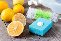 Lemon and sodium bicarbonate. Eco-friendly natural cleaners baking soda, lemon and cloth on wooden table Royalty Free Stock Photos
