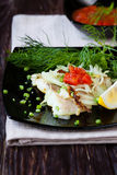 Lemon sole fillets roasted with onions Royalty Free Stock Images
