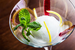 Lemon sorbet. Delicious lemon sorbet in a glass stock images
