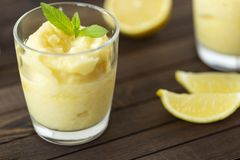 Lemon sorbet in a glass. Delicious cooling dessert stock photos
