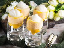 Lemon sorbet ice cream served dessert. Lemon sorbet ice cream served as gourmet dessert stock photography