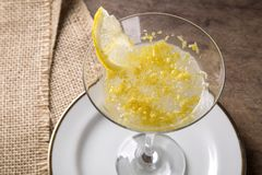 Lemon sorbet on a wood background.  Royalty Free Stock Image