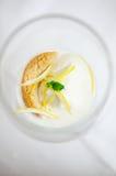 Lemon sorbetto. Lemon sorbet with amaretti biscuit and lemon zest Stock Image
