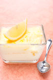 Lemon souffle in a glass form, vertical Stock Images