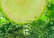 Lemon in sparcle water drops. Lemon in sparkle water background,sparkle water drops on glass for background or backdrop. Green abstract sparkle water background Royalty Free Stock Photos