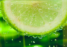 Lemon in sparcle water drops Stock Photos