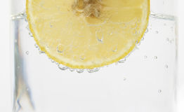 Lemon in sparkling water Stock Image