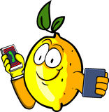 Lemon speaking on a smartphone while reading a tablet Royalty Free Stock Photography