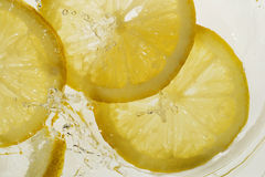 Lemon splash. Bubbles Royalty Free Stock Photography