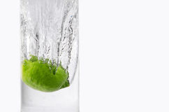 Lemon Splash. Studio shot of a lemon splashing on water, isolated on white Stock Images
