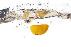 Lemon splash. Isolated Lemon splashing in water Royalty Free Stock Image
