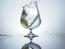 Lemon splash. Play with water and fruits Royalty Free Stock Photography