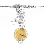 Lemon splash in water. Isolated on white Royalty Free Stock Photo