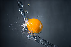 Lemon and splash of water on grey background. Lemon and splash of water on grey background Royalty Free Stock Photo