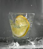 Lemon splash wave down Stock Photography