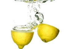 Lemon splashing Stock Photos