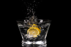 Lemon Splashing In Water Stock Images