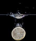 Lemon splashing Stock Photography
