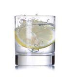 Lemon splashing in water Stock Images