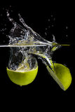 Lemon splashing into the water Stock Images