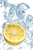 Lemon splashing in water Stock Photography