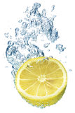 Lemon splashing in water Royalty Free Stock Photography