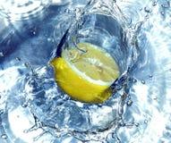 Lemon splashing water Stock Photo