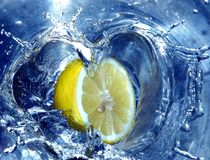 Lemon splashing water stock image
