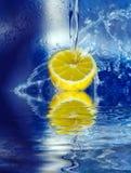 Lemon splashing in water Stock Photography