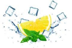 Lemon splashing water and ice Stock Images