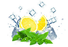 Lemon splashing water and ice Royalty Free Stock Photography