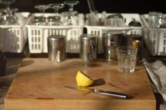 Lemon split and knife on Chopping wood behind coffee shop as bac royalty free stock images