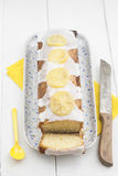 Lemon sponge cake with candied lemon slices and icing on top Royalty Free Stock Photo