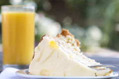 Lemon Sponge Cake and Orange Squash Royalty Free Stock Photos