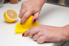 Lemon squeeze juice woman hands Stock Image