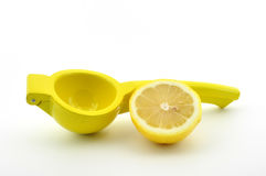 Lemon squeezer with lemon isolated Royalty Free Stock Image