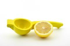 Lemon squeezer with lemon isolated. Lemon squeezer with half a lemon isolated on a white background Royalty Free Stock Image