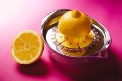 Lemon squeezer on pink background Stock Photo