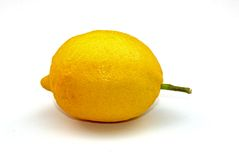Lemon with stem. A close-up of a yellow lemon with a stem stock images