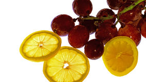 Lemon and still life picture of grapes Royalty Free Stock Image