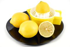 Lemon and strainer Royalty Free Stock Image