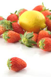 Lemon among strawberries Royalty Free Stock Images