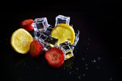 Lemon and strawberry on ice. Cold and healthy fruit Royalty Free Stock Photography