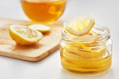 Lemon with sugar is in a glass jar Royalty Free Stock Photos